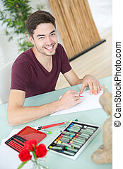 portrait of man drawing at home