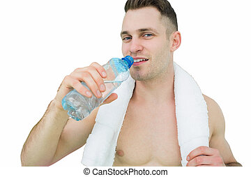 Portrait of man drinking water with towel around neck