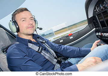 Portrait of man in cockpit of plane