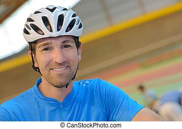 Portrait of man in cycling helmet