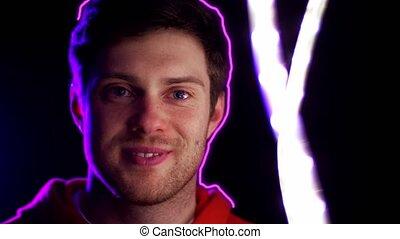 portrait of man in dark room over neon lights
