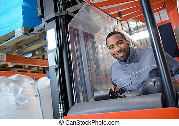 Portrait of man in forklift