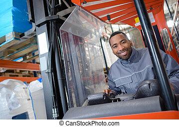 Portrait of man in forklift truck