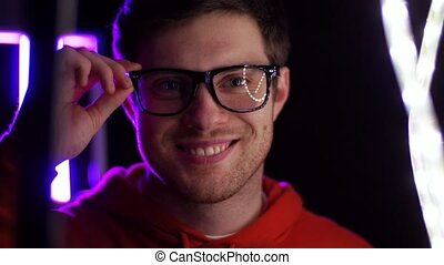 portrait of man in glasses over neon lights - vision,...