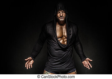 Portrait of man in hood. - Portrait of handsome man with ...