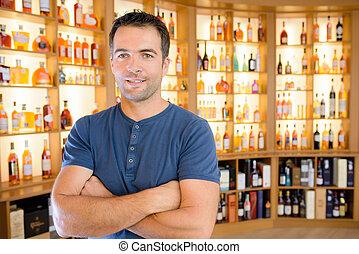 Portrait of man in liquor store
