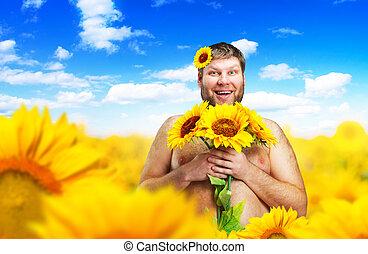 Portrait of man in sunflower field