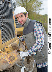 Portrait of man next to plant machinery