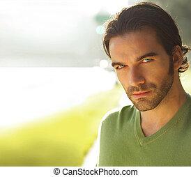 Portrait of man outdoors