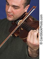 portrait of man playing violon