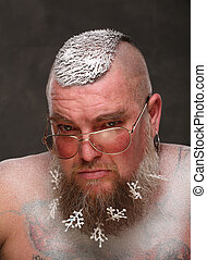 Portrait of man spectacled a long beard with snowflakes