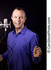 Portrait of man talking on microphone