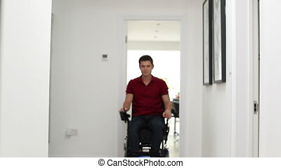 Portrait Of Man Using Motorized Mobility Scooter At Home