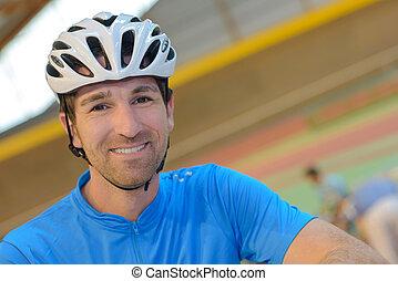 Portrait of man wearing cycling helmet
