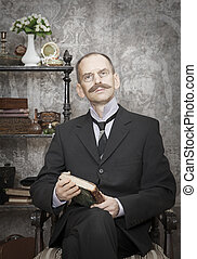 Portrait of man with a book. Intentional 1900's style ...