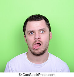 Portrait of man with funny face against green background