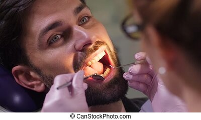 Portrait of man with open mouth in dental office - Close-up ...