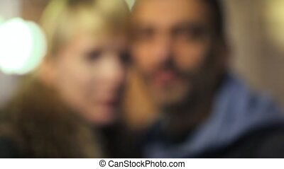 portrait of man with woman, camera moving forward