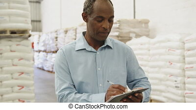 Portrait of man working in a warehouse 4k - Portrait close ...