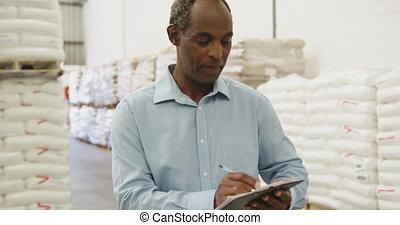 Portrait of man working in a warehouse 4k