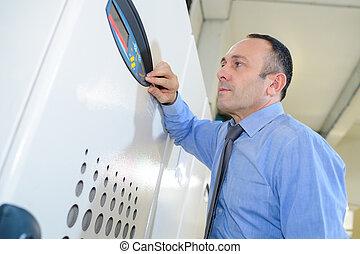 portrait of man working with machine