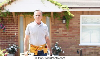 Portrait Of Mature Builder With Tools Outside House