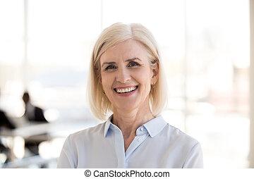 Portrait of mature businesswoman posing smiling at camera