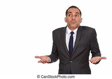 Portrait of mature Persian businessman shrugging shoulders