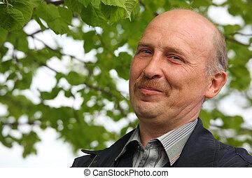 portrait of mature smiling man outdoor