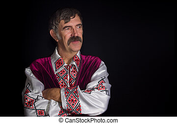 Portrait of mature Ukrainian country-man in traditional clothes