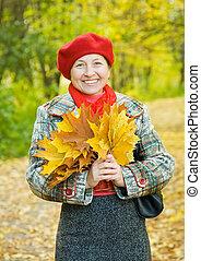 Portrait of mature woman in autumn park