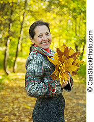 Portrait of mature woman  in autumn