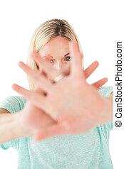Portrait of mature woman signals st