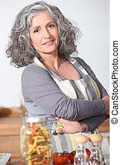 Portrait of mature woman wearing apron