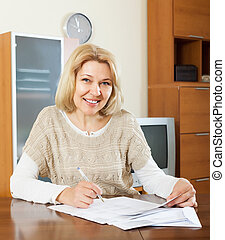 mature woman with  documents