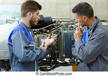 portrait of men checking the engine