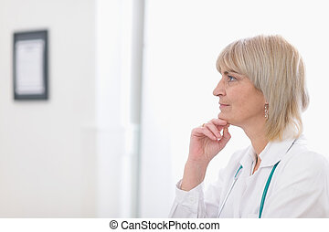 Portrait of middle age doctor woman looking on copy space
