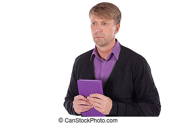 Portrait of middle age man dressed in cardigan with a notebook on white background