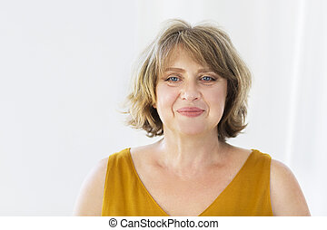 Portrait of middle age woman in the room