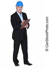 portrait of middle-aged architect holding clipboard