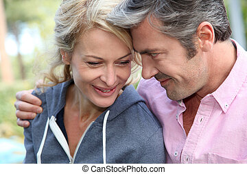 Portrait of middle aged couple looking at each other