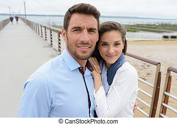 portrait of middle-aged couple on a pier
