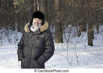 Portrait of middle-aged man in the winter forest