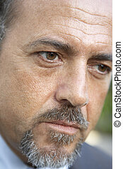 Portrait Of Middle Aged Man Looking Serious
