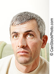 Portrait of middle aged man looking up