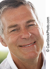 Portrait Of Middle Aged Man Smiling At The Camera