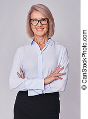 middle aged smiling business woman isolated