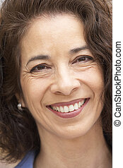 Portrait Of Middle Aged Woman Smiling At The Camera