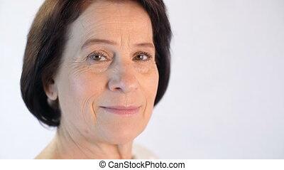 Portrait of middle aged woman - closeup portrait of elegant...