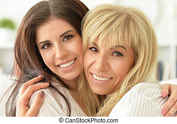 woman with daughter at home